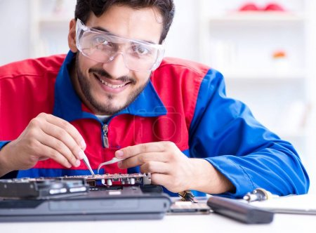 Photo for Repairman working in technical support fixing computer laptop troubleshooting - Royalty Free Image