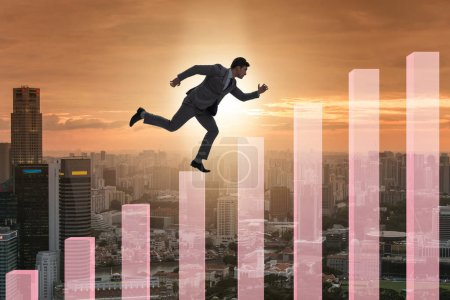 Photo for The businessman climbing bar charts in growth concept - Royalty Free Image