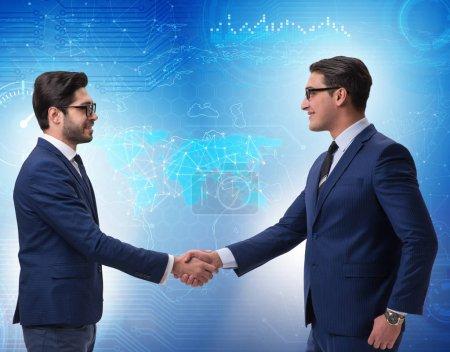 Photo pour The business cooperation concept with businessmen hand shaking - image libre de droit