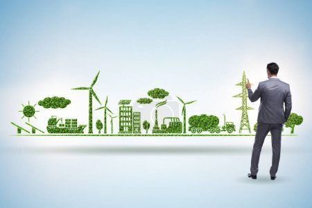 Businessman in green and environmental concept