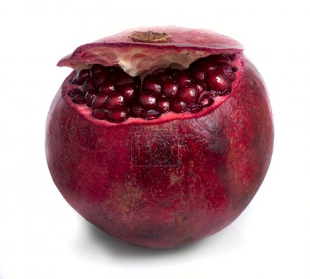 close-up of ripe fresh pomegranate fruit isolated on white background
