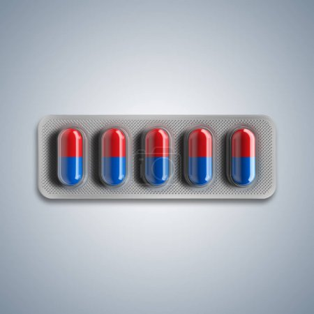 Red and blue pills in a blister on gray background