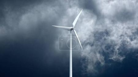 Wind power generators on sky background.