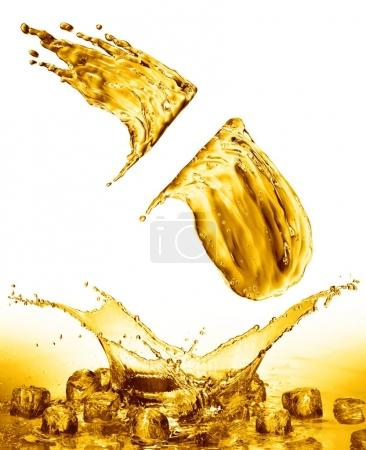 oil splash on gold bokeh background