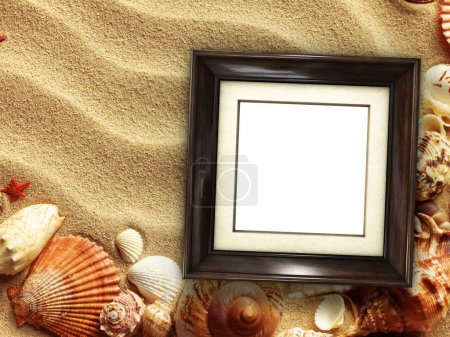 Photo for Pictue frame on shells and sand background. Copy space. - Royalty Free Image