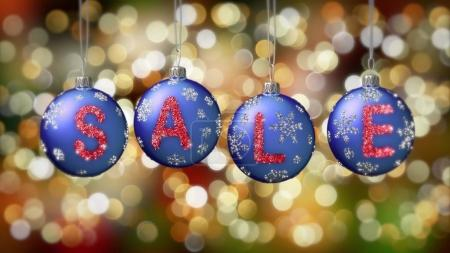 Sale banner on blue Christmas balls with round snow flake on gold bokeh background.