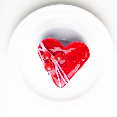 Photo for Red heart cake with jelly on white plate - Royalty Free Image