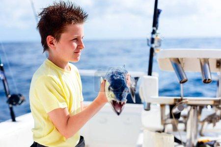 Boy deep sea fishing