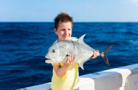 Boy deep sea fishing