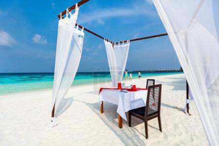 Photo for Romantic luxury dinner or lunch setting at tropical beach in Maldives - Royalty Free Image