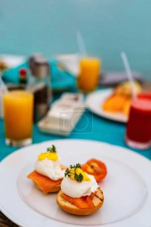 Photo for Delicious breakfast with eggs Benedict, vegetables and coffee - Royalty Free Image