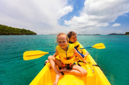 Kids kayaking in ocean