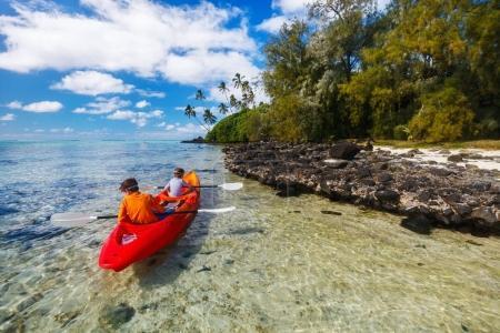 Kids kayaking in ocean