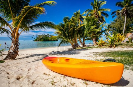 Photo for Colorful kayak at beautiful tropical beach with palm trees, white sand, turquoise ocean water and blue sky at Cook Islands, South Pacific - Royalty Free Image