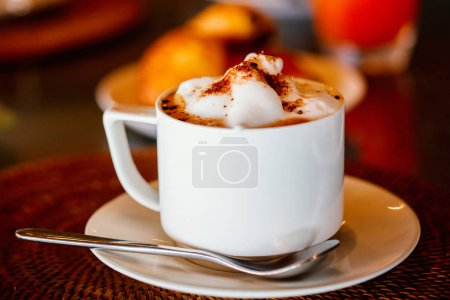 Fresh coffee in white cup