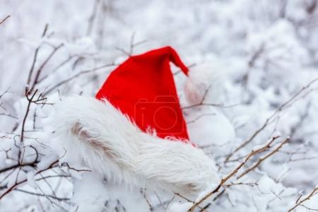 Christmas Santa hat on snow