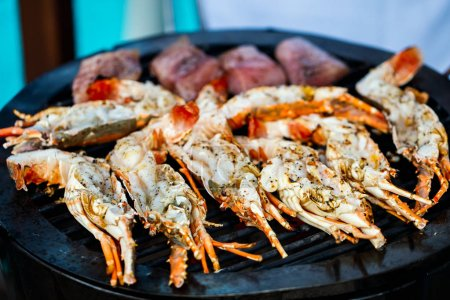 Lobsters and crayfish grilling