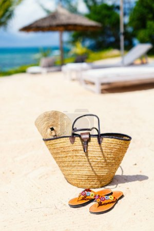 Straw bag on a tropical beach