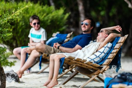 Father and kids on beach