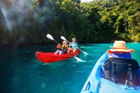Family kayaking in mangroves