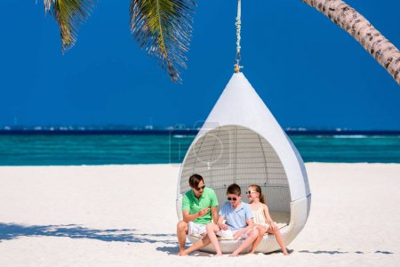 Photo for Father and kids enjoying beach vacation on tropical island - Royalty Free Image