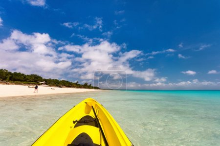 Colorful kayak at beautiful tropical beach with white sand, turquoise ocean water and blue sky
