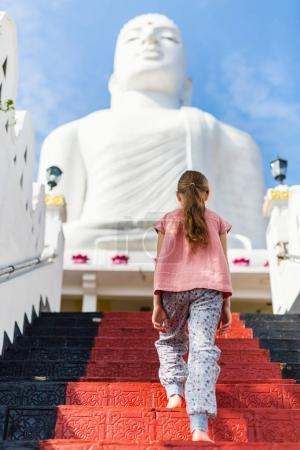Little girl exploring Bahirawakanda temple in Kandy Sri Lanka