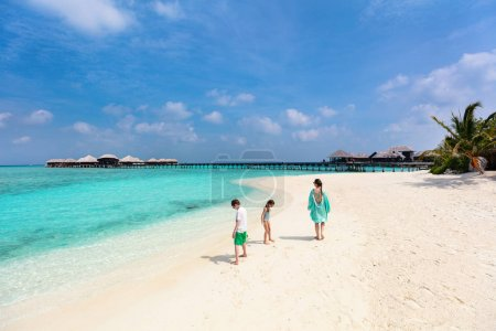 Photo for Family mother and kids enjoying tropical beach vacation - Royalty Free Image