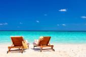 """Постер, картина, фотообои """"Деревянные шезлонги на красивом тропическом пляже в Мальдивы"""""""