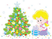 Girl with a Christmas gift A vector illustration of a little girl with her holiday gift near a colorfully decorated Christmas tree