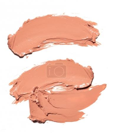Photo for Collection of beige smear crushed cosmetic products on a white background - Royalty Free Image