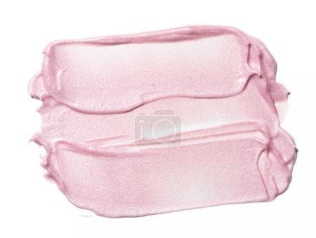 Photo pour Collection de produits cosmétiques broyés au frottis rose sur fond blanc - image libre de droit