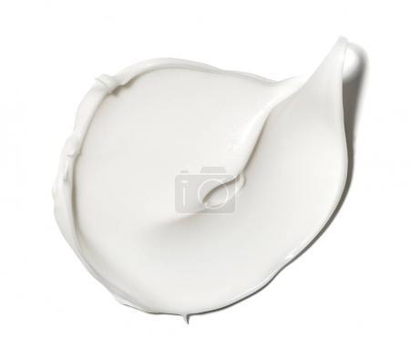 Photo pour Frottis peinture de produits cosmétiques blancs sur un fond blanc - image libre de droit
