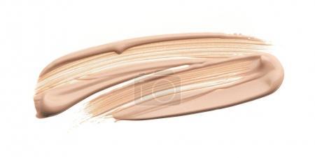 Photo pour Frottis peinture de produits cosmétiques sur un fond blanc - image libre de droit