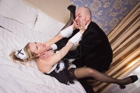 Sexual chambermaid bothers the guest. He angrily attacks her and