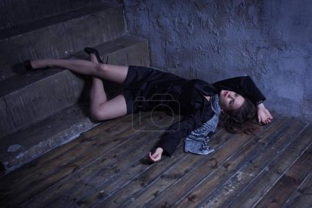 Crime scene with strangled retro styled fashion woman in a darkp