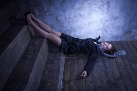 Crime scene with strangled retro styled fashion woman in a darkp