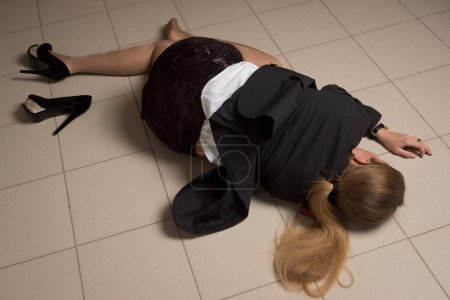 Crime scene with strangled business woman in office
