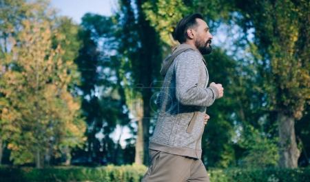 Jogging man in nature.