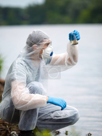 Chemist takes sample of water