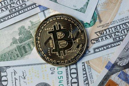 Photo bitcoin on dollar bills
