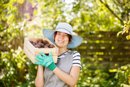 Woman with potato in box