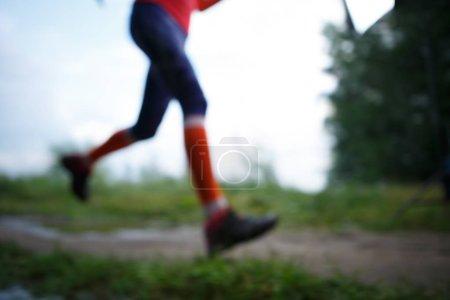 Blurred photo of running woman