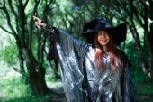 Image of witch in gray cloak