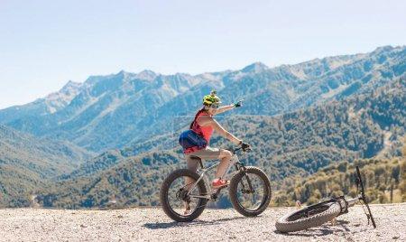Photo of girl in helmet at bicycle