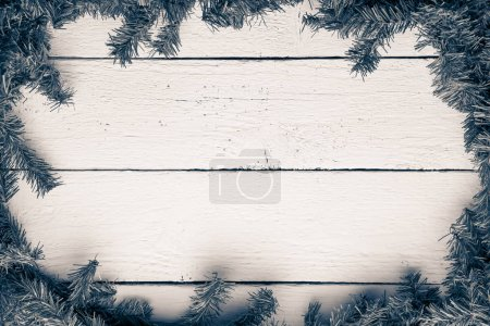 Wooden board with fir branches. Christmas and new year backgroun