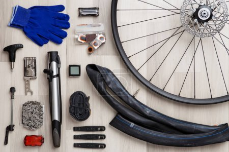 Image of bicycle objects on wooden background.