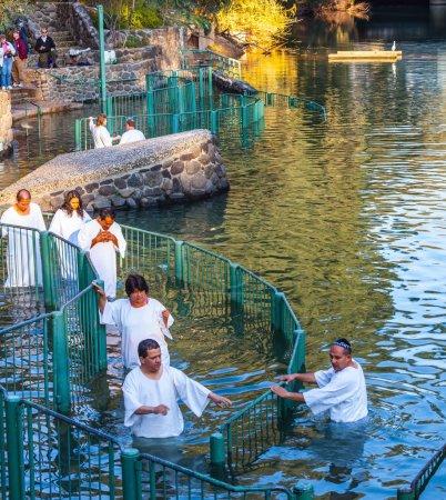 Christian pilgrims enter Jordan River