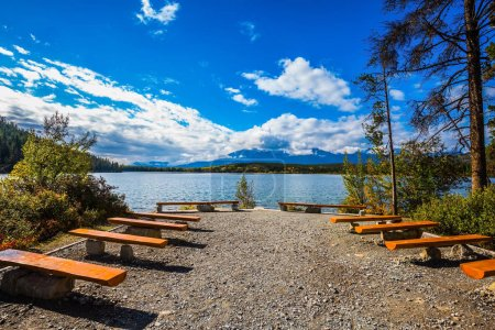 wooden benches on shore of cold Lake