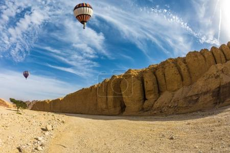 Balloon flying over desert